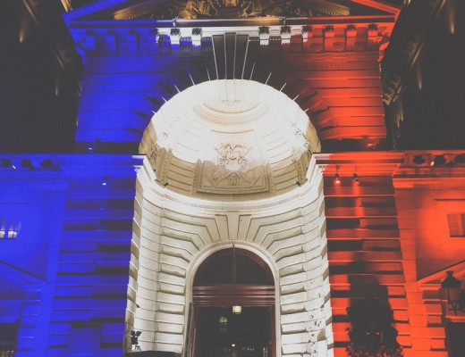Illuminated Paris building as French Flag